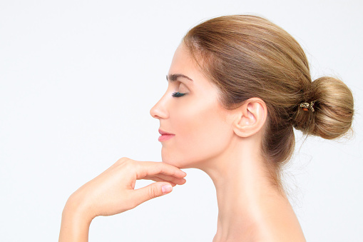 Side profile of patient's smooth face after recieving botox at Todd L. Jolly, DMD, Nutley, NJ